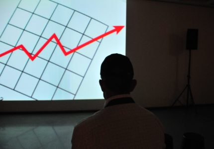 Man watching a line graph increasing